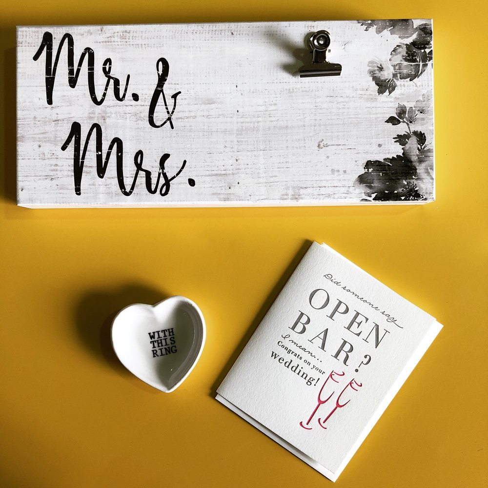 Gifts for the Happy Couple - From greeting cards that will make you LOL, ring trinkets, and beautiful signs that can hold a note for the Happy Couple.  We do complimentary gift wrap to bring it all together!