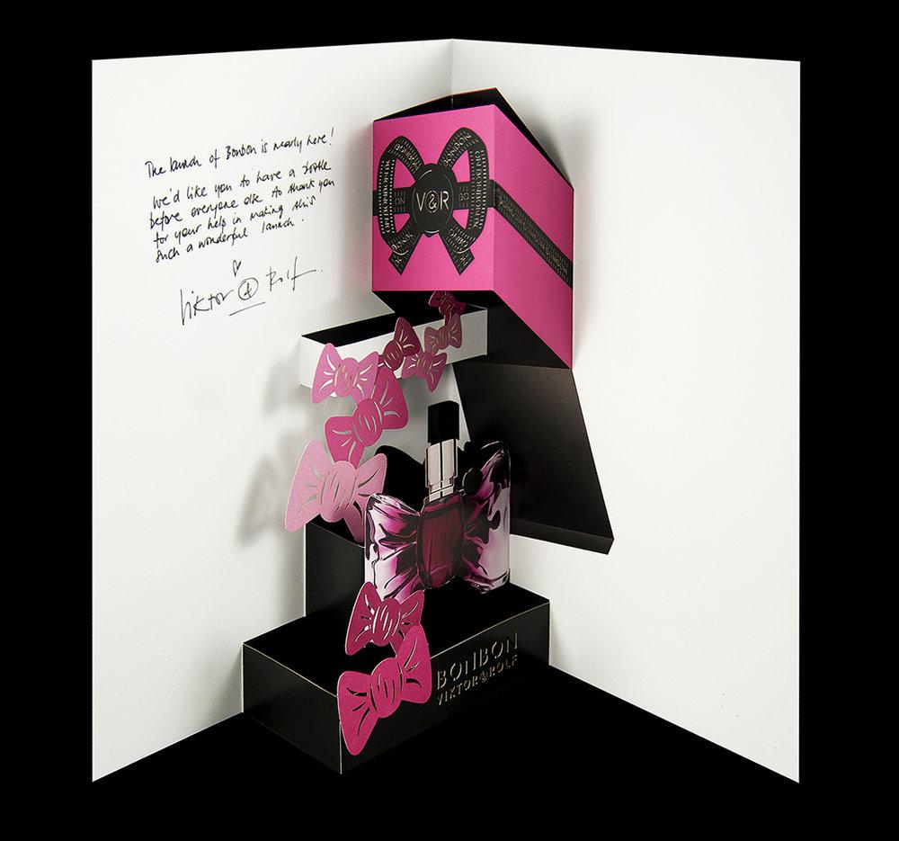 BonBon perfume promotional launch layered pop-up card.