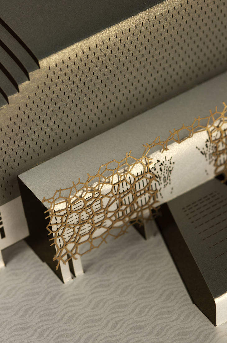 Detail shot of gold lattice laser-cut overlay and spot UV foil water pattern onto pearlescent white card.