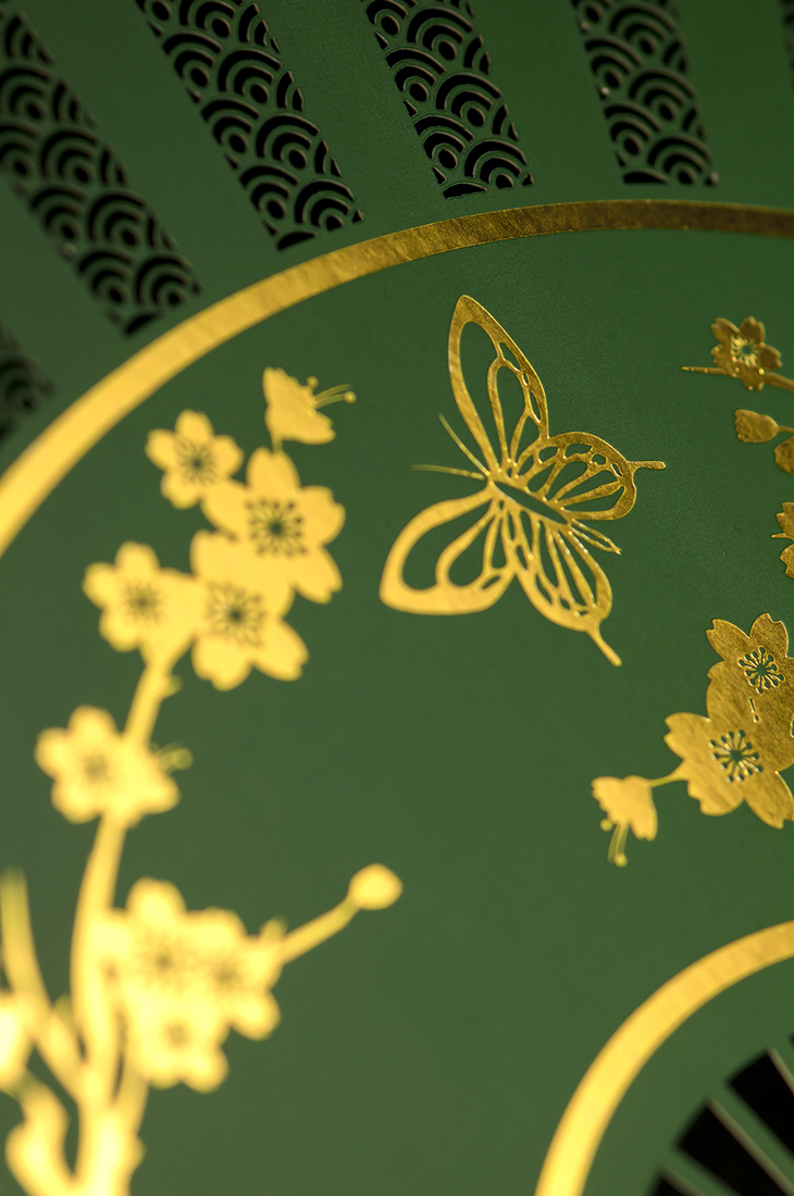 Detail shot of gold foiling and laser-cutting.