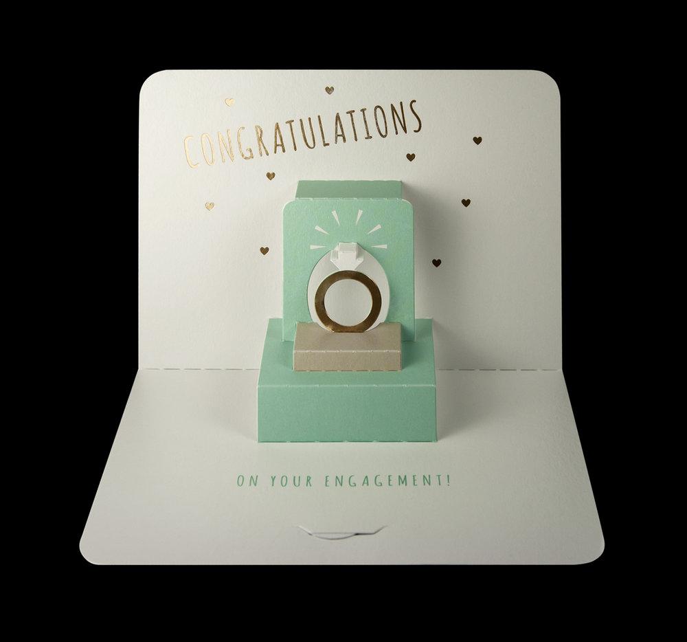 Illustrative 'Congratulations' ring pop-up card