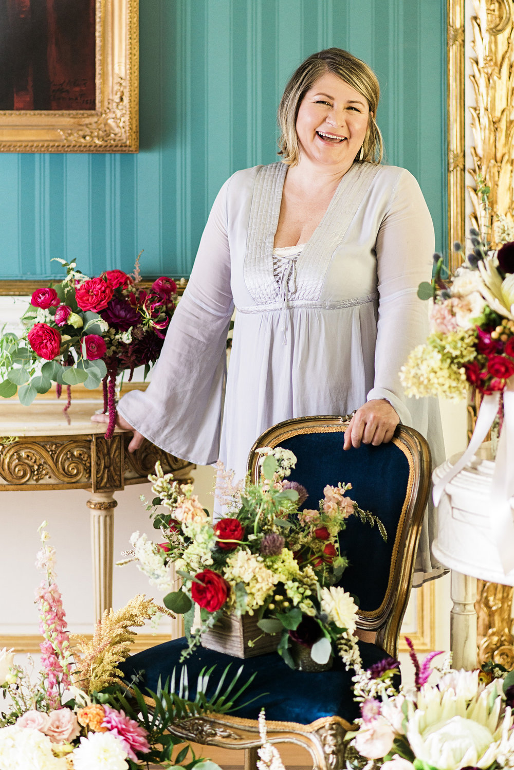 LANA BROWN  Lana Brown, owner and head designer of Fleur De Lis, has a passion for floral design and cutting edge techniques.  She brings her inspiration from a love of travel and cultural experience, providing a unique tone to all of the arrangements.  She started working at Fleur de Lis in 2011, when the studio was owned by the previous designer, and later inherited the business in 2015 to keep the legacy alive.  Being a small flower shop owner allows her to spread beauty and excitement in her local community. She has a deep affection for engagement stories and hearing about how couples come together, working side by side to help them adorn one of their most memorable dates. Whether it's weddings or a simple bouquet, Lana can make any client's vision fully blossom!