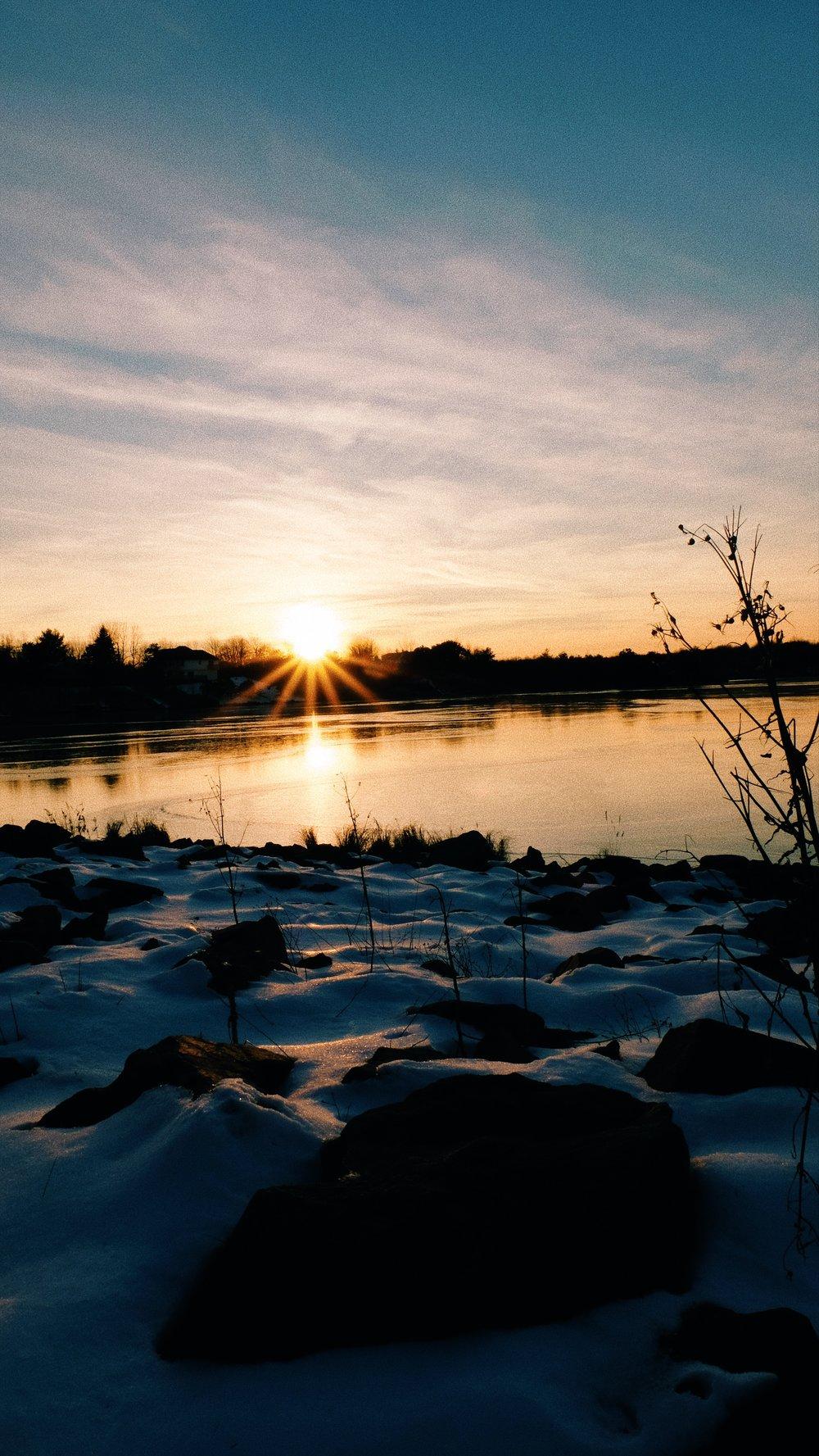 golden-hour-sun-lake-rocks-snow.JPG