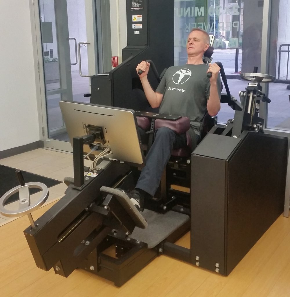 Thomas, one of the New Element Training instructors, on the MedX Lumbar Extension Machine