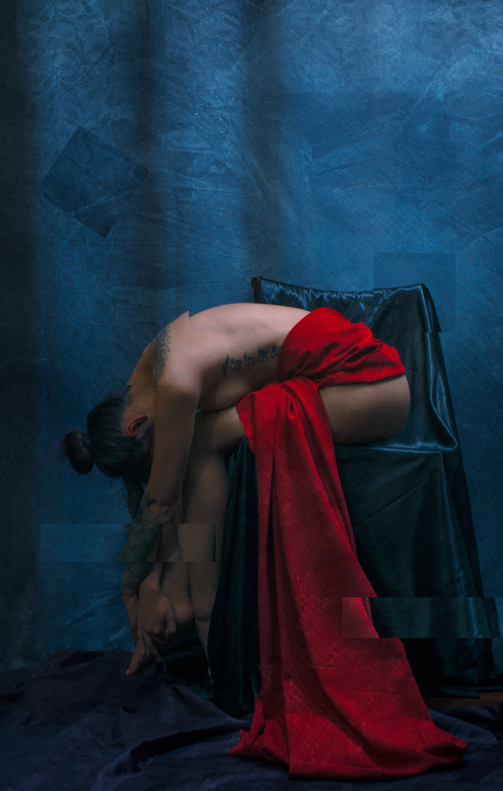 Fine art nude photograph of Angelina by Jason Matias. The model is draped in red cloth on a blue backdrop to create a striking contrast in the image. The photo is overlayed with layers of texture and appears as a painting with abstract cubist elements.