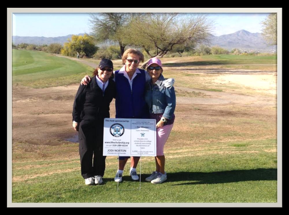 Three ladies participating in the Diva's Golf Tournament