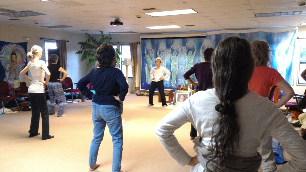 Denise leading a Morning Qigong Practice of Hip Rotation at a Wisdom Healing Qigong Retreat at EarthRise IONS in Petaluma, CA.