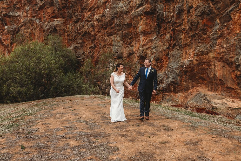 bride and groom being captured by dookie quarry wedding photographer