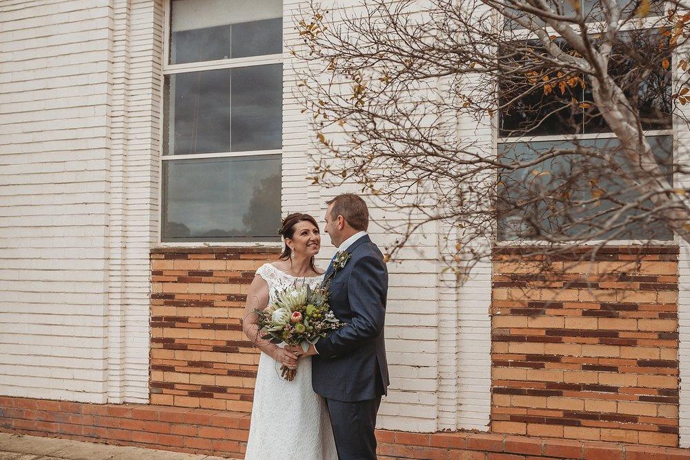 bride and groom in main street of dookie