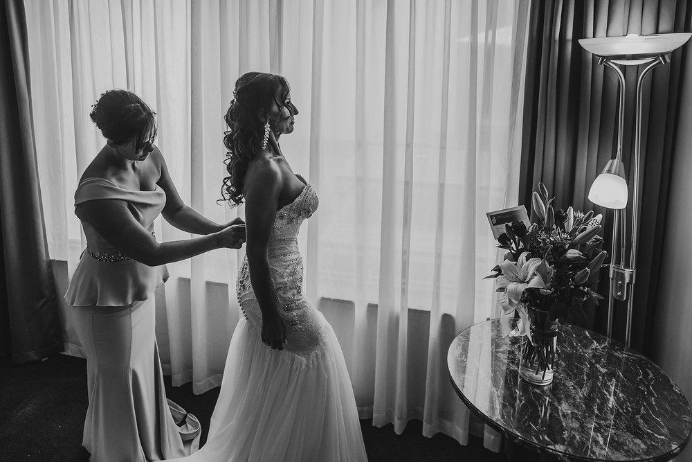 bride getting dressed at brighton savoy