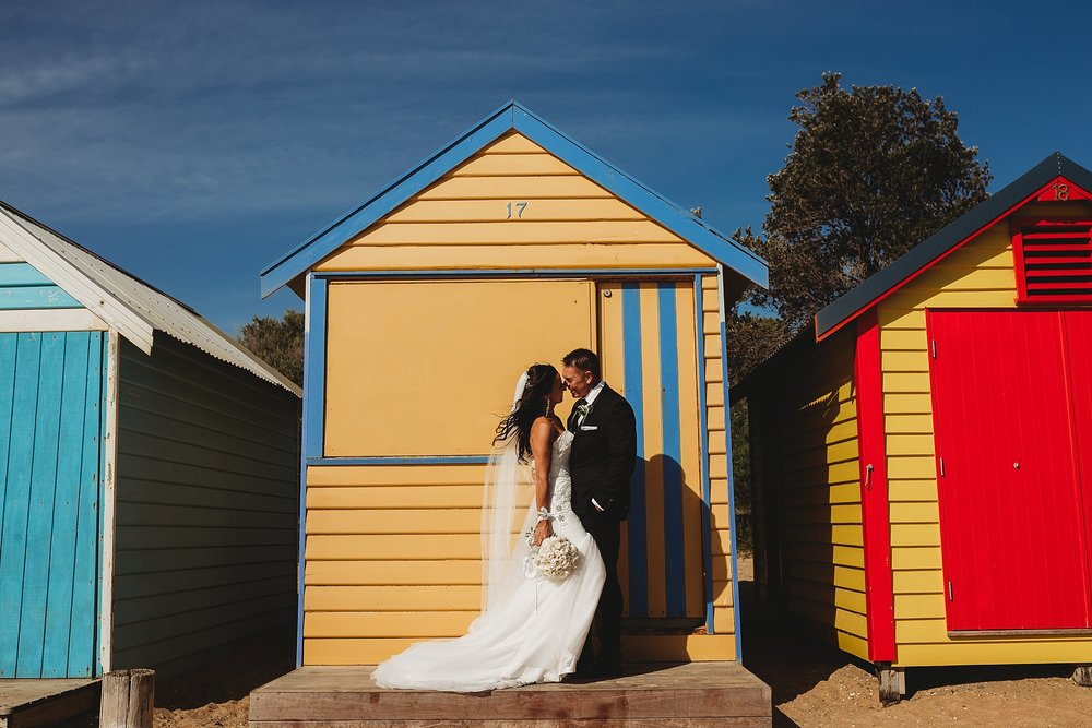 bride and groom at brighton beach boxes