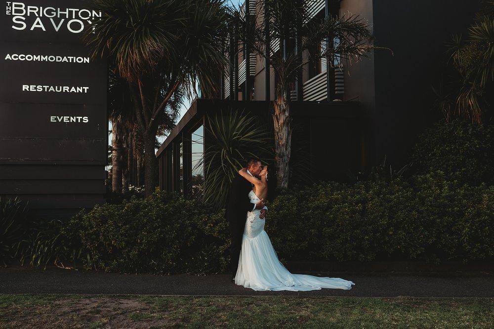 bride and groom posing at brighton savoy melbourne