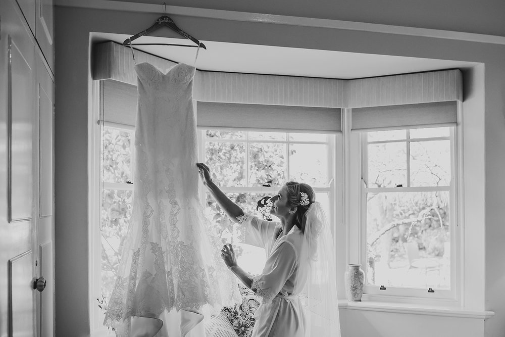 Bride looking at bridal gown