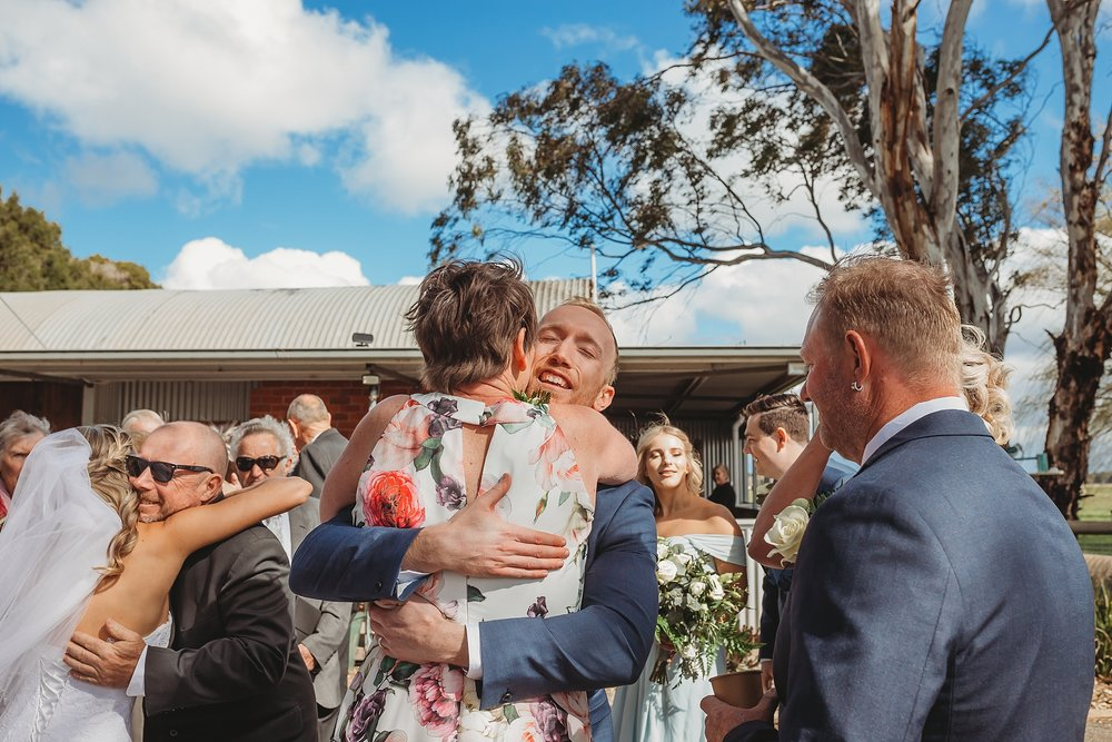 mum hugging groom