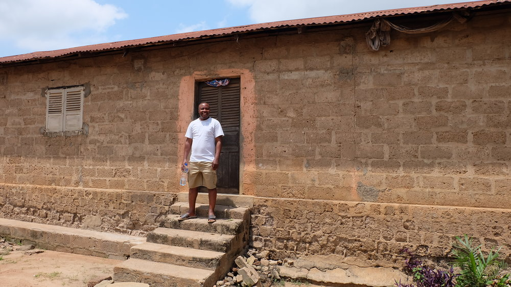 Ro outside the home he shared with his 21 siblings while growing up in Notsé, Togo