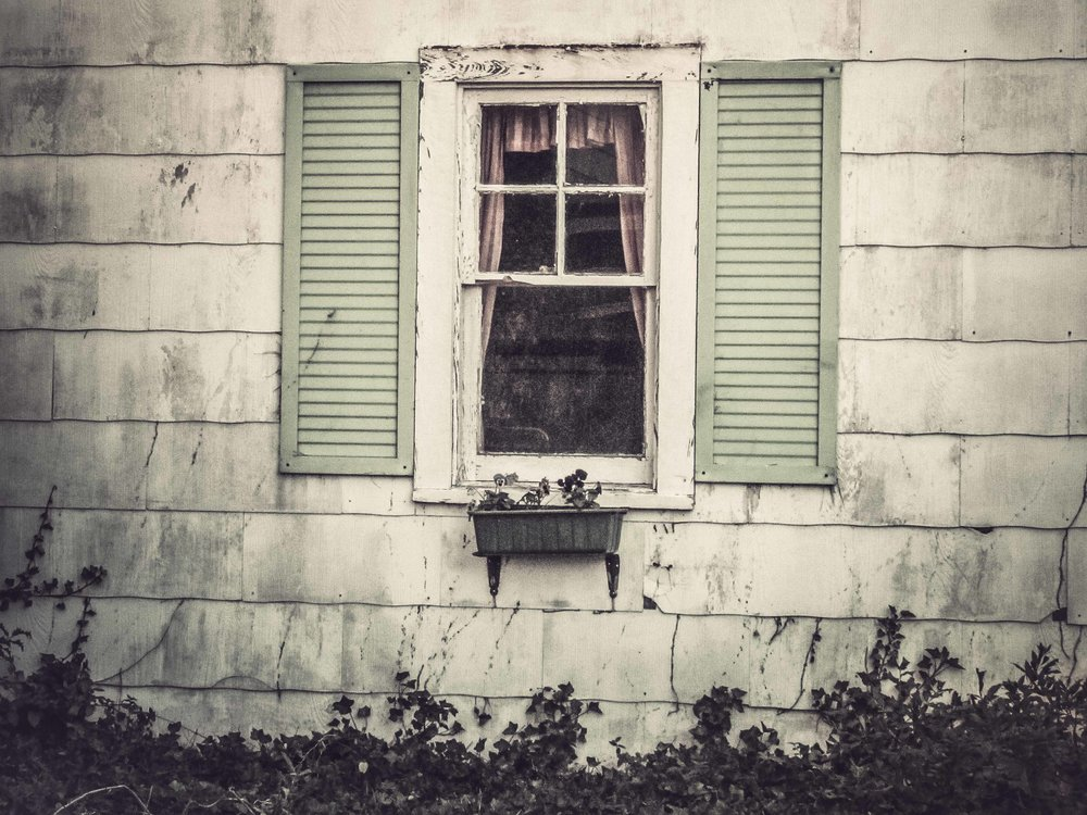 Window of an abandoned house  Photograph: Rose Anderson, 2013