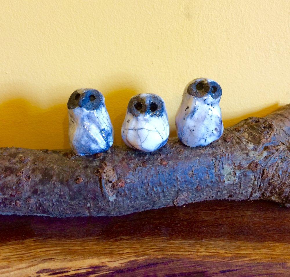 Raku owls on log