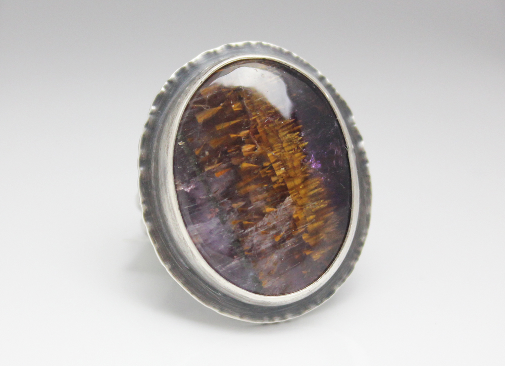 Cacoxenite in Amethyst ring