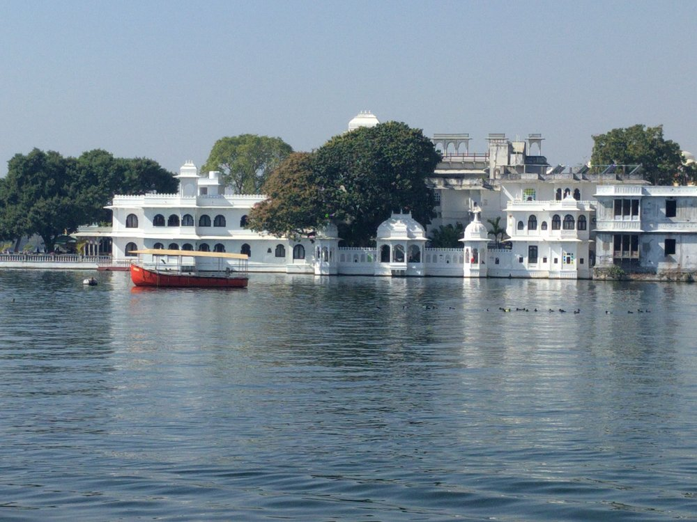 Boats, temples and fine hotels line the peaceful banks of Lake Pichola