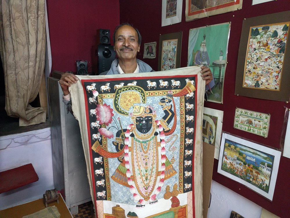 Traditional handpainting artists still occupy their family shops in Udaipur