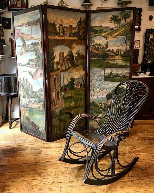 Old fashioned is the new fashion. Victorian Irish? naive painted three-fold screen, with vignettes of landscapes, and an early 20th century American stick-ware rocking chair. #nicsnacs #rockingchair #screen #antique #antiquesforsale #interiordesign #interiors #collection #homedecoration #ireland #irish #love  #peace #folkart