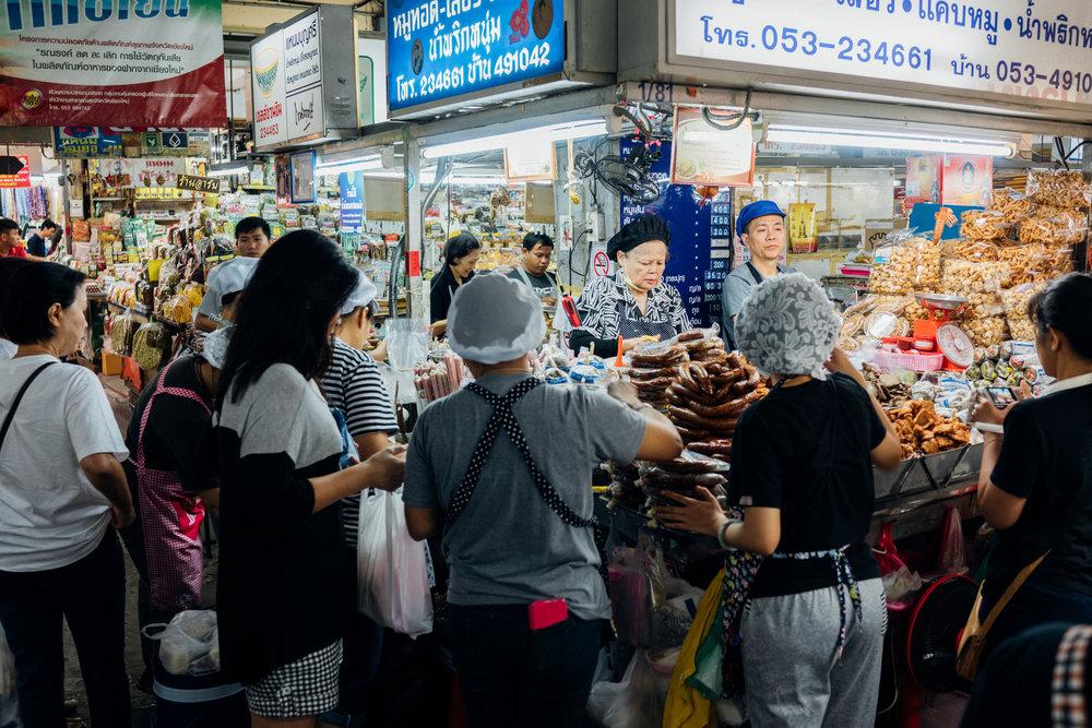 A very popular s ai sa  (ไส้อั่ว) vendor at Warorot Market in Chiang Mai, Thailand