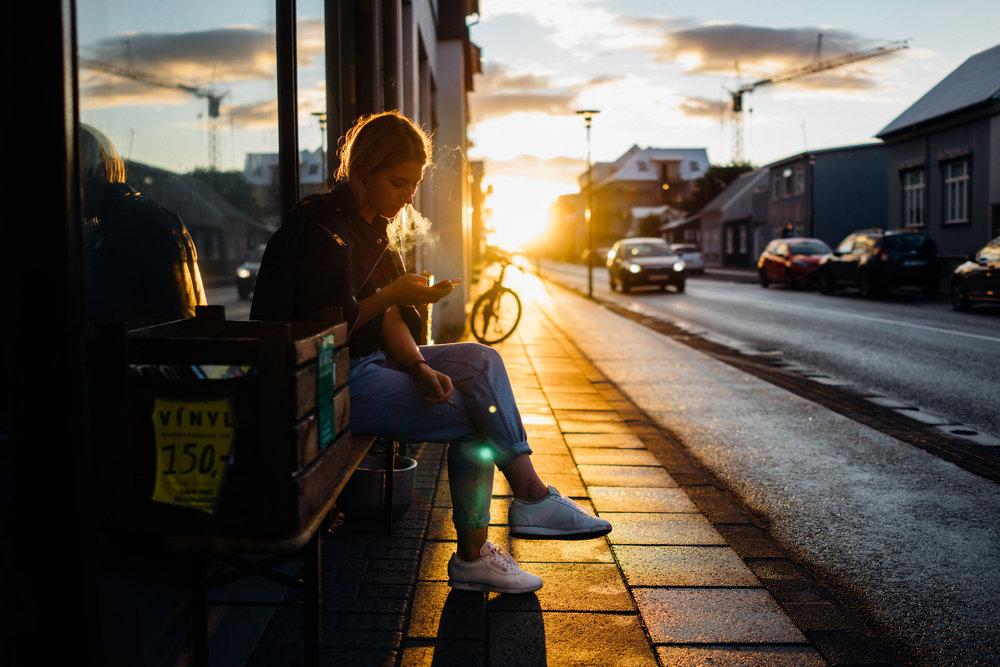 Matylda, a  fantastic photographer , on Hverfisgata, as the sun is setting on Reykjaviík