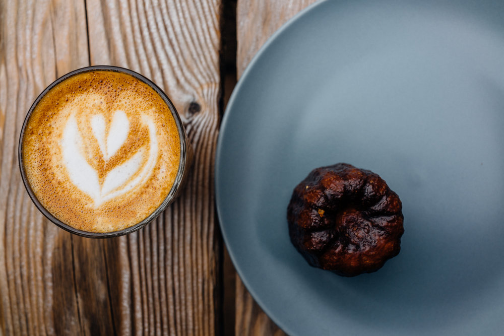 A cortado and canelé at  Dispatch Coffee  in the Mile X neighborhood