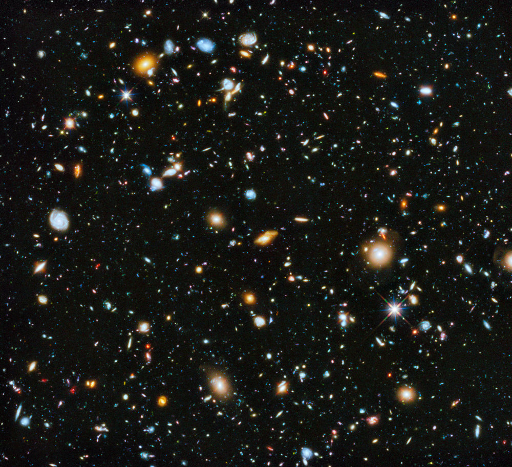 NASA's Hubble Ultra-Deep Field (HUDF) is an image of a small region of space in the constellation Fornax, containing an estimated 10,000 galaxies. Some of these galaxies date from 13 billion years ago, between 400 and 800 million years after the Big Bang.