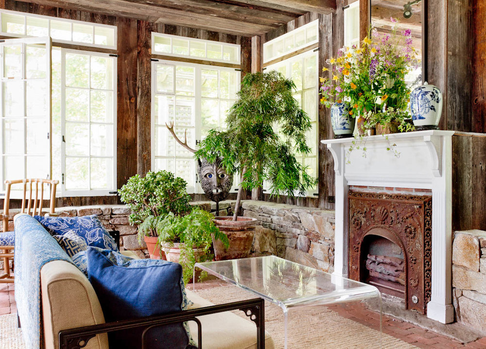 rustic-connecticut-farmhouse-porch-fireplace.jpg
