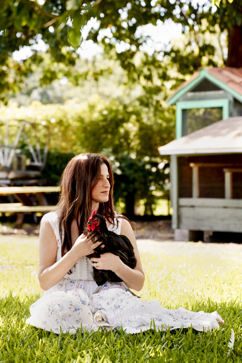 woman-holding-farm-chicken-lifestyle-photography.jpg
