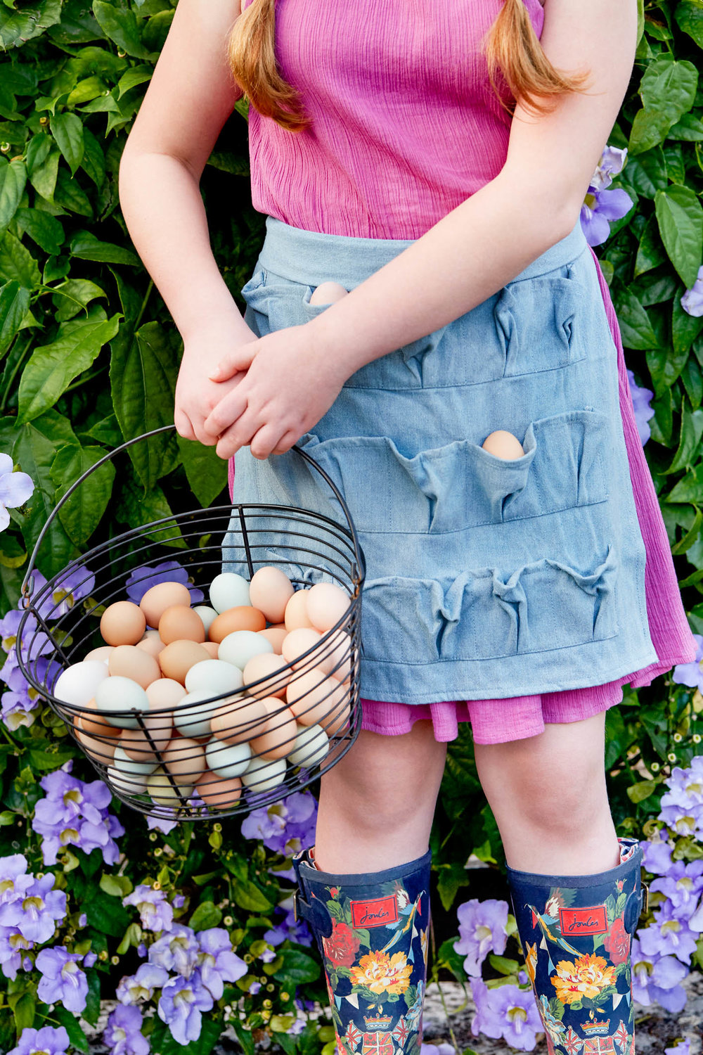 girl-holding-egg-basket.jpg