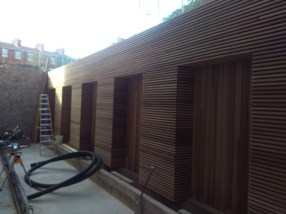 Floating cedar planter build in the basement of the new st Anne's college library Oxford