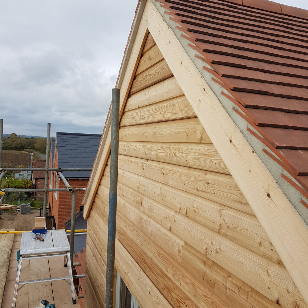 Softwood cladding fitted to a new build in thame