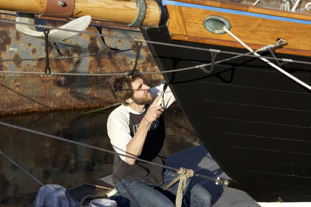 Developing Craftsmenship - Carpenter Garrett DeMirjian works on ROSE OF SHARON's topsides.