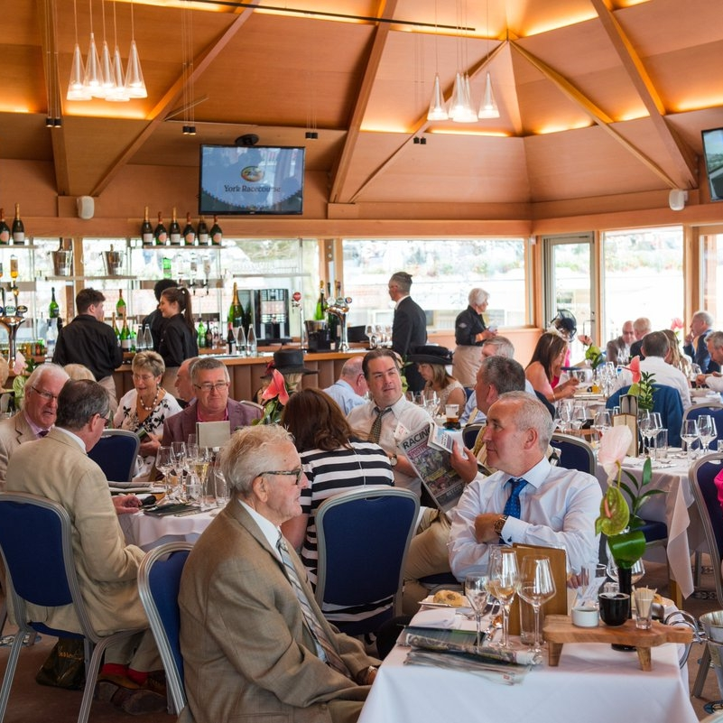 Parade Ring Restaurant - From £185 Per PersonThe Parade Ring Restaurant provides an ideal location for a fine dining experience, situated on the top floor of the Weighing Room, overlooking the Parade Ring, saddling boxes and pre-parade ring.