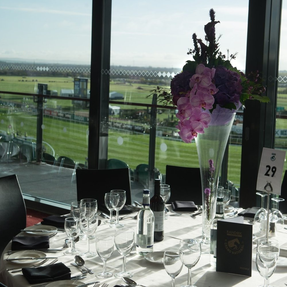 Pappilon Restaurant Hospitality - £259 Per Person- Premier admission to the Earl of Derby grandstand- Private balcony overseeing the Grand National track- Exquisite views of the Parade Ring & Weighing Room- Delicious three-course luncheon- Afternoon tea- Complimentary bar throughout the day including a selection of wines, beers & soft drinks- Jockey Club host experience- Official race card- Car parking