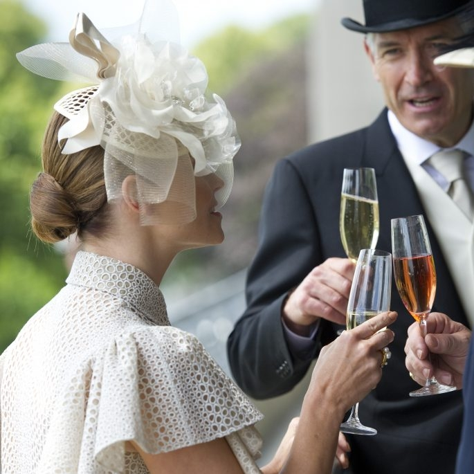The Lawn Club - Upper - Starting at £449 Per PersonWe are proud to offer the best in official Royal Ascot hospitality packages for the 2018 meeting, as an Official Hospitality Supplier (OHS) appointed directly by Ascot.A brand new facility will be in evidence in 2018, with an elevated second-floor suite above The Lawn Club.This facility, yet to be given an official name, replaces the Sandringham Restaurant.  We are therefore referring to this option as The Lawn Club - Upper for the time being.  The benefit of this location is that all racing action takes place immediately in front of you and the Royal Procession will pass directly in front of the facility.Bookings can be made for a minimum of two guests, with private tables guaranteed for parties of 8 or more.
