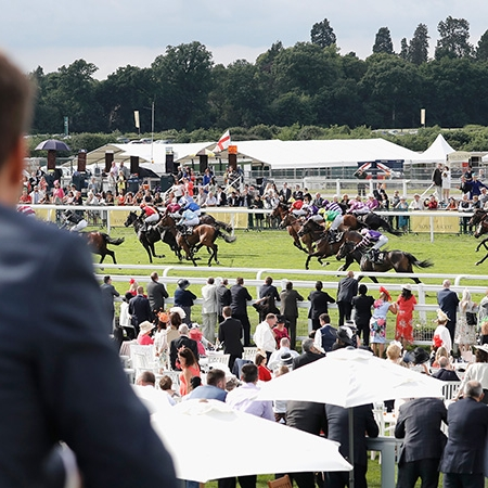 The Lawn Club - We are proud to offer the best in official Royal Ascot hospitality packages for the 2018 meeting, as an Official Hospitality Supplier (OHS) appointed directly by Ascot.The Lawn Club is a beautiful, elevated track-facing structure with uninterrupted views of the course from a private viewing balcony, with a giant screen directly opposite, ensuring you don't miss any of the thrilling action.Situated right at the heart of the trackside excitement and just 300 metres from the winning line, The Lawn Club allows you to experience the pomp and pageantry of Royal Ascot with informal dining in an intimate surrounding.Bookings can be made for a minimum of two guests, with private tables available for parties of 8 or more.