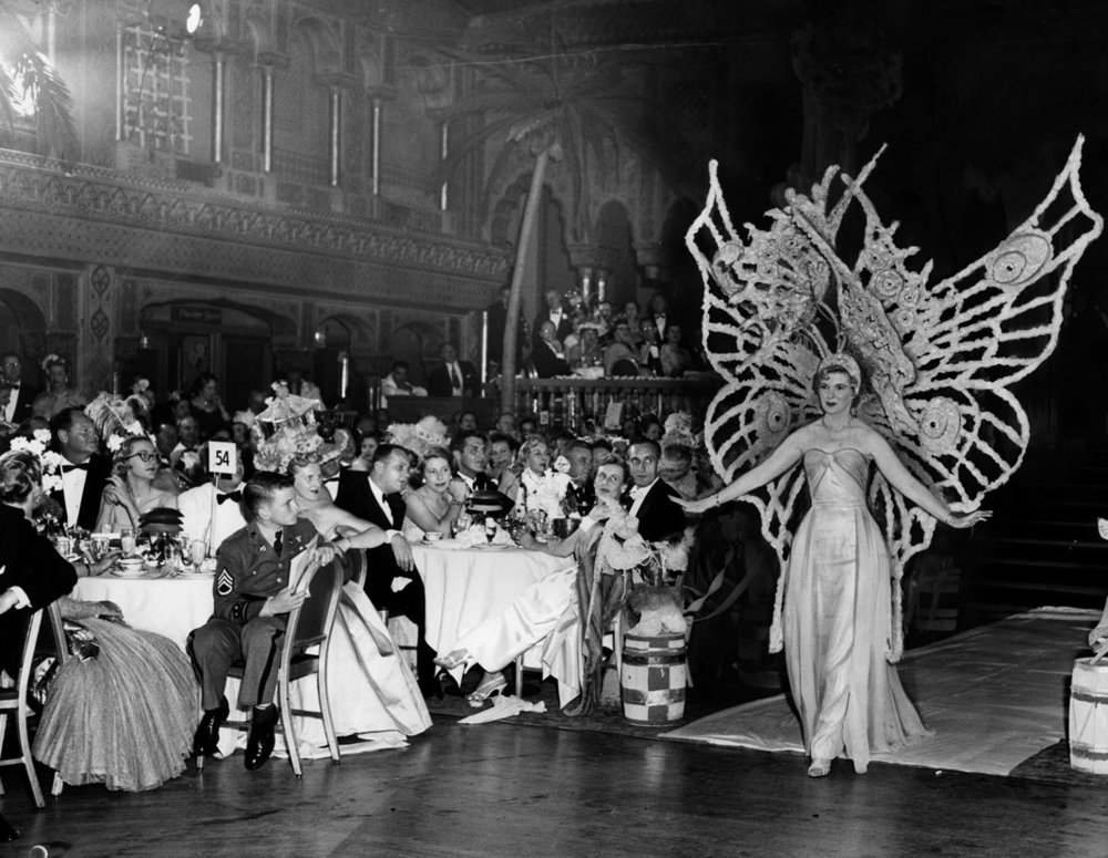"The ""Las Floristas 17th Annual Floral Headdress Ball"" at the Cocoanut Grove.  Photo via Los Angeles Public Library by Tom Courtney (1955)"