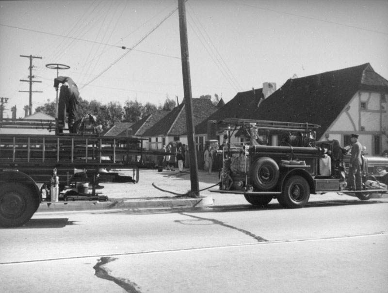 Fire trucks outside the Snow White Cottages  Photo by Herman Schultheis via Los Angeles Public Library (c. 1930s)
