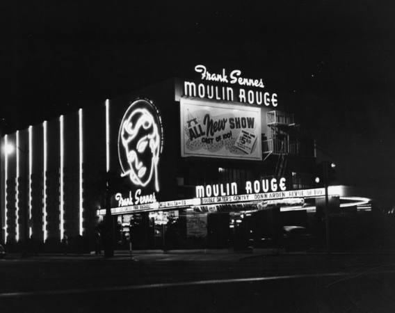Exterior of the Theater with new signage for Frank Sennes' Moulin Rouge. Photo via Los Angeles Public Library (1954)