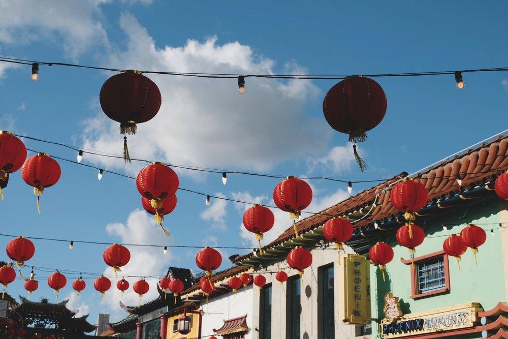 Hanging chinese lanterns in Chinatown
