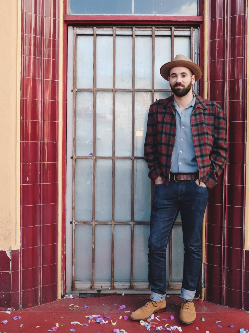 Nate standing in front of red tile doorway in Chinatown