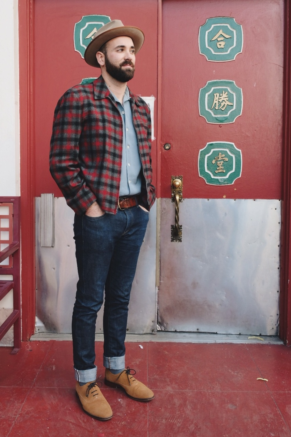 Nate in front of red ornate door in Chinatown