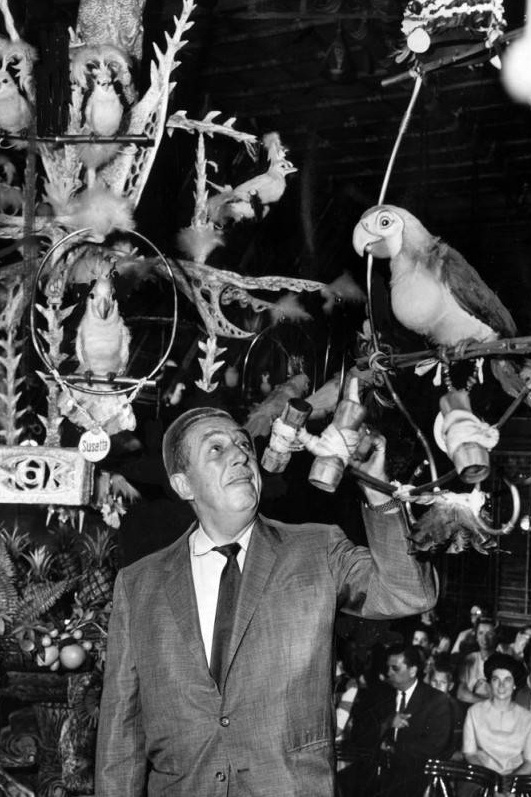 Walt Disney inside Disneyland's Enchanted Tiki Room, featuring feather from California Millinery Supply Co. (1963). Photo via Los Angeles Public Library Digital Collections