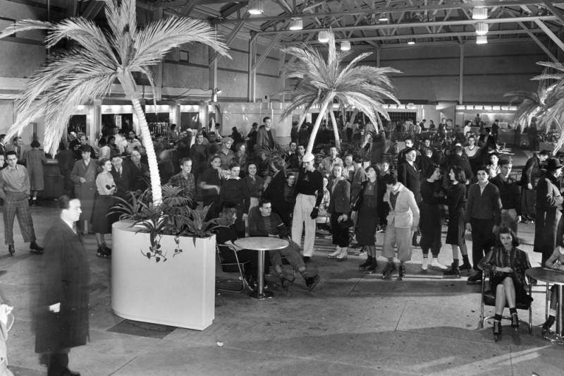 Ice skaters waiting in the concession stand area of the Pan-Pacific Auditorium ice skating rink. Photo via LA Public Library (year unknown)