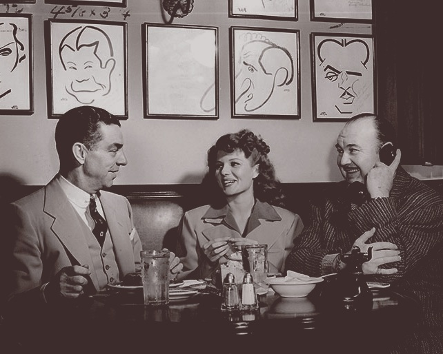 Robert Cobb, Rita Hayworth, and Paul Whitman at the Hollywood Brown Derby (1949). Photo via  The Hollywood Reporter.
