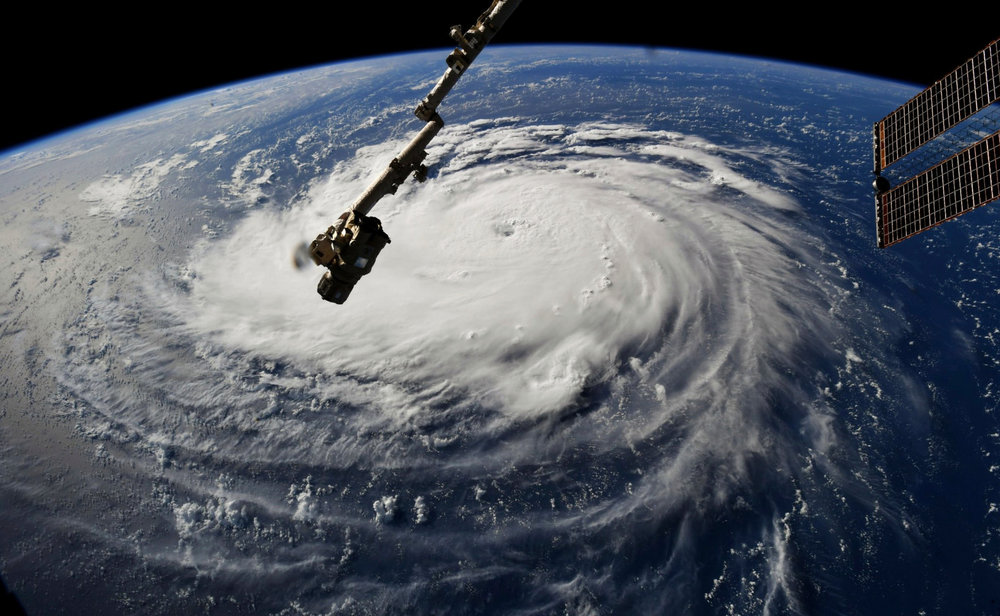 Hurricane Florence as seen from the International Space Station.  Hurricane Florence sprawled over a large area of the Atlantic on Monday as it built strength and headed for the East Coast [ Credit = NASA, via Associated Press]