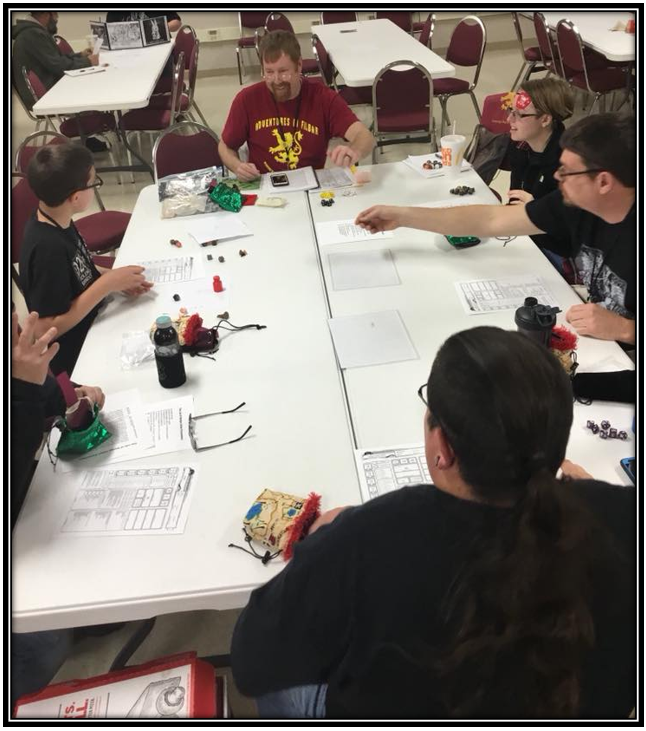 Frank Schmidt, founder and author of   Adventures in Filbar   running his AD&D-5e scenario   Infiltration of Taco Del Toro   at the 2018  CAFCON Fantasy, Gaming, and Roleplaying Convention .